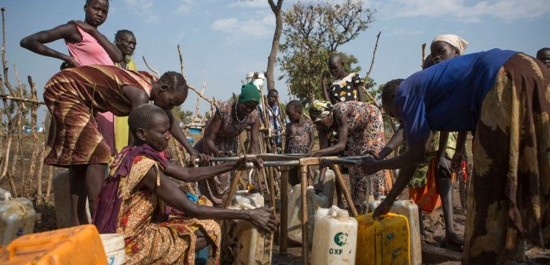 Women work to collect water in the Nguneyyiel refugee camp in the Gambella region of Ethiopia on 26 Nov 2017. Photo by: Zacharias Abubeker