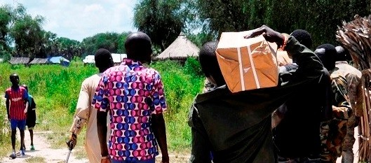 SPLA-IO soldiers carry boxes with forms delivered by JMCC members to register forces in Ayod County on September 24, 2019. (Photo: Radio Tamazuj)