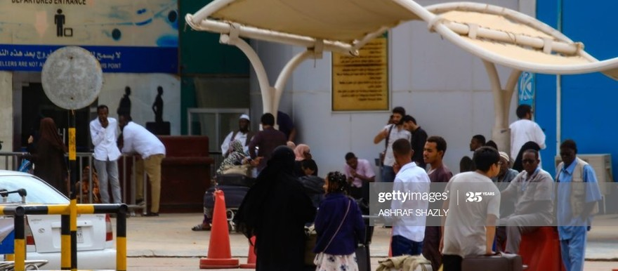 Passengers wait outside the departure terminal at Khartoum airport on May 28, 2019 (Photo: ASHRAF SHAZLY/AFP via Getty Images)
