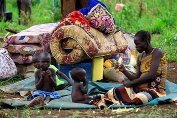 File photo: An elderly woman displaced by fighting in South Sudan rests by her belongings in Lamwo after fleeing fighting in Pajok town across the border in northern Uganda, April 5, 2017. (REUTERS/James Akena)