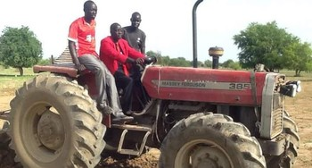 File photo: Commissioner Santo Amuol (middle) driving a tractor during the inauguration of the youth farm. (Radio Tamazuj)
