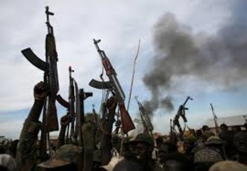 File photo: Rebel fighters hold up their rifles as they walk in front of a bushfire in a rebel-controlled territory in Upper Nile State, February 13, 2014. (REUTERS)