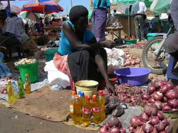 Photo: Woman selling commodities in Juba market (Nile merchant)