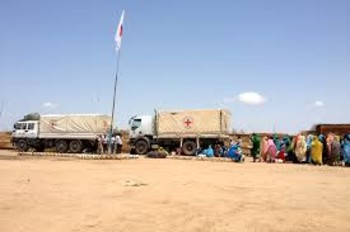 Photo: Sudan trucks arrive carrying food, seed and farming tools to be distributed to families in and around Jebel Marra (ICRC).