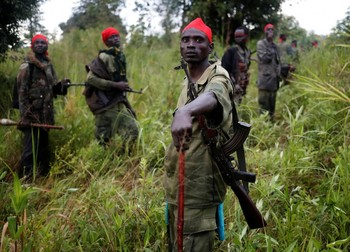 SPLA-IO (SPLA-In Opposition) rebels stand after an assault on government soldiers, outside the town of Kaya, August 26, 2017. REUTERS/Goran Tomasevic