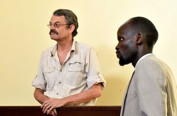 William John Endley stands in the dock as his Lawyer Gar looks on, in the High Court in Juba February 13, 2018. REUTERS