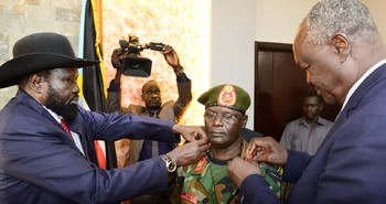 Photo: Gabiel Jok Riak being promoted by President Kiir before swearing in as new chief of general staff on May 4, 2018.