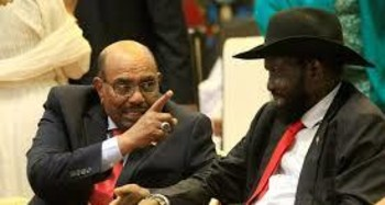 South Sudan's President Salva Kiir (right) talks to Sudan's President Omar Hassan Al Bashir after signing a ceasefire and power-sharing agreement with South Sudanese rebel leader Riek Machar in Khartoum, Sudan, on August 5 (Reuters photo)