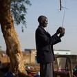 Photo: A displaced South Sudanese man tunes his radio  (BBC)