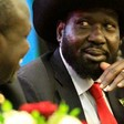 South Sudan's President Salva Kiir (right) talks to rebel leader Riek Machar. MOHAMED NURELDIN ABDALLAH / REUTERS